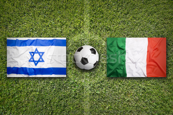Israel vs. Italy flags on soccer field Stock photo © kb-photodesign