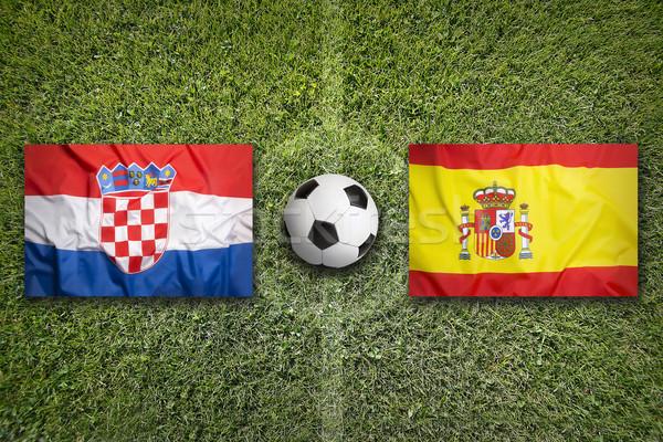 Croacia vs España banderas campo de fútbol verde Foto stock © kb-photodesign