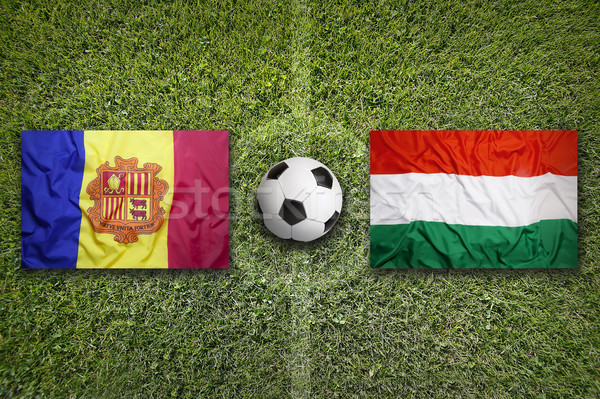 Stock photo: Andorra vs. Hungary flags on soccer field