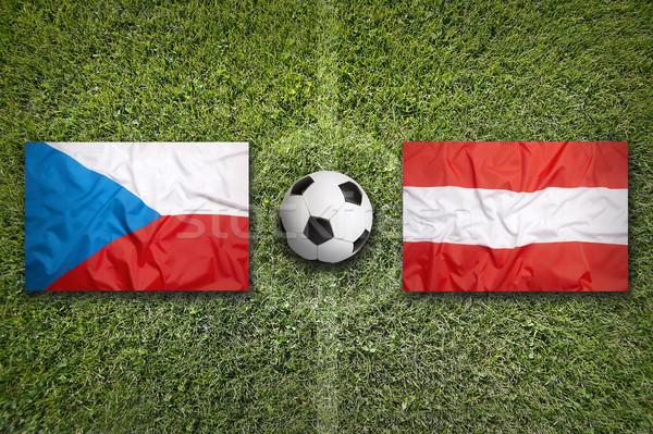 Stock photo: Czech Republic vs. Austria flags on soccer field