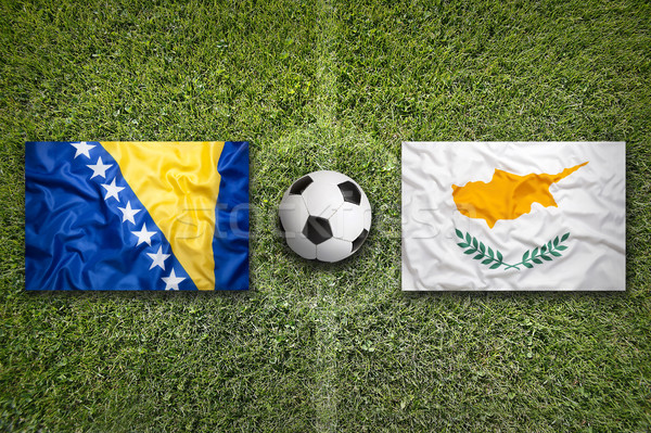 Bosnia and Herzegovina vs. Cyprus flags on soccer field Stock photo © kb-photodesign