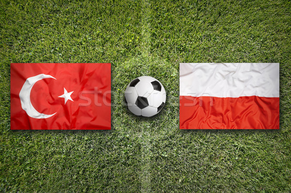 Turkey vs. Poland flags on soccer field Stock photo © kb-photodesign