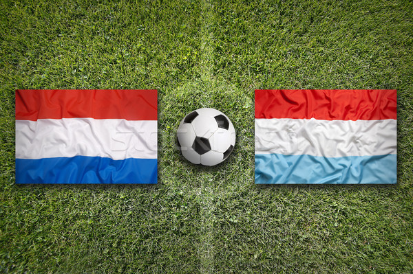 Netherlands vs. Luxembourg flags on soccer field Stock photo © kb-photodesign