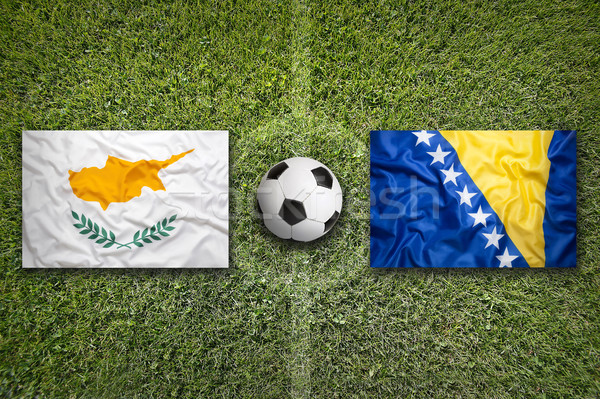 Cyprus vs. Bosnia and Herzegovina flags on soccer field Stock photo © kb-photodesign