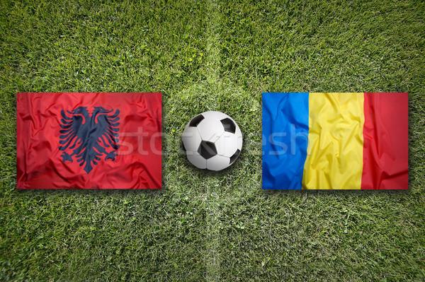 Albanië vs Roemenië vlaggen voetbalveld groene Stockfoto © kb-photodesign