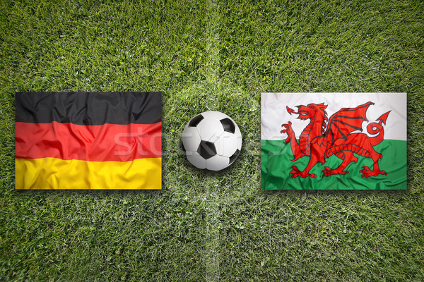 Germany vs. Wales flags on soccer field Stock photo © kb-photodesign