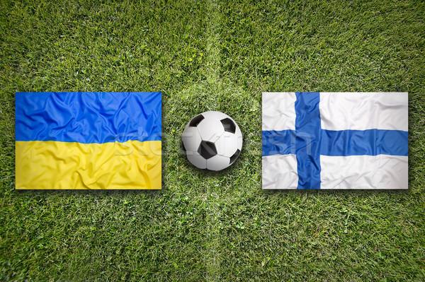 Ucrânia vs Finlândia bandeiras campo de futebol verde Foto stock © kb-photodesign