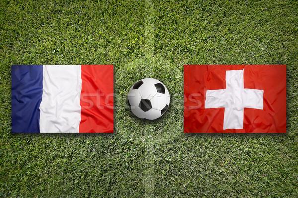 France vs. Switzerland flags on soccer field Stock photo © kb-photodesign