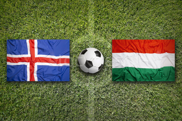 Iceland vs. Hungary flags on soccer field Stock photo © kb-photodesign