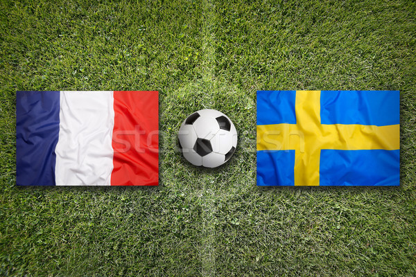 Frankrijk vs Zweden vlaggen voetbalveld groene Stockfoto © kb-photodesign
