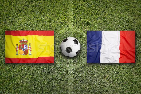 Spanyolország vs Franciaország zászlók futballpálya zöld Stock fotó © kb-photodesign