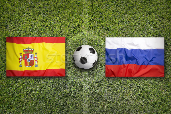 Spain vs. Russia flags on soccer field Stock photo © kb-photodesign