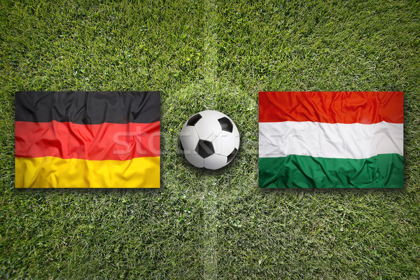 Germany vs. Hungary flags on soccer field Stock photo © kb-photodesign