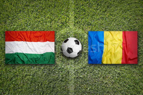 Hungary vs. Romania flags on soccer field Stock photo © kb-photodesign
