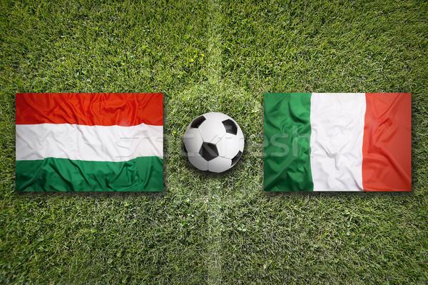Hungary vs. Italy flags on soccer field Stock photo © kb-photodesign