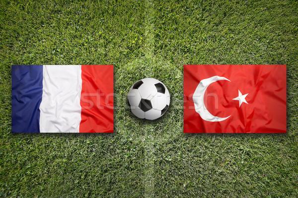 Fransa vs Türkiye bayraklar futbol sahası yeşil Stok fotoğraf © kb-photodesign