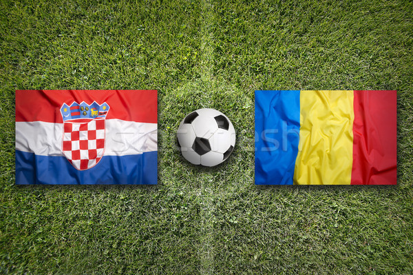 Croatia vs. Romania flags on soccer field Stock photo © kb-photodesign
