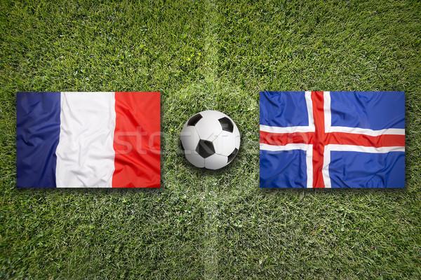 Fransa vs İzlanda bayraklar futbol sahası yeşil Stok fotoğraf © kb-photodesign