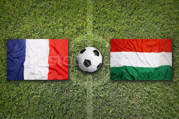 Fransa vs Macaristan bayraklar futbol sahası yeşil Stok fotoğraf © kb-photodesign