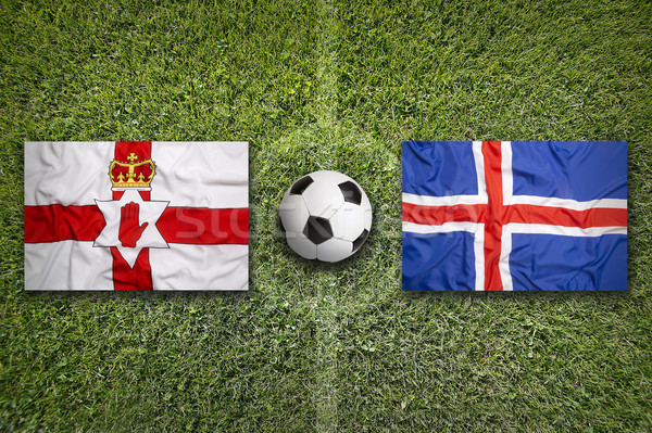 Northern Ireland vs. Iceland flags on soccer field Stock photo © kb-photodesign
