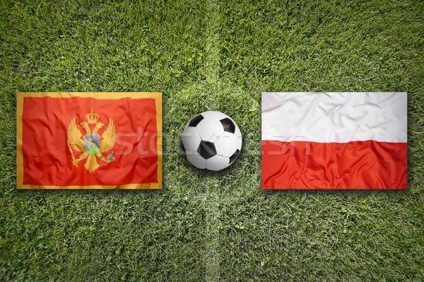 Monténégro vs Pologne drapeaux terrain de football vert Photo stock © kb-photodesign