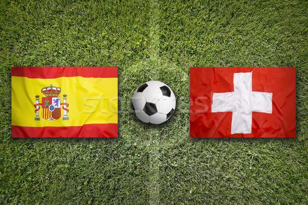 España vs Suiza banderas campo de fútbol verde Foto stock © kb-photodesign