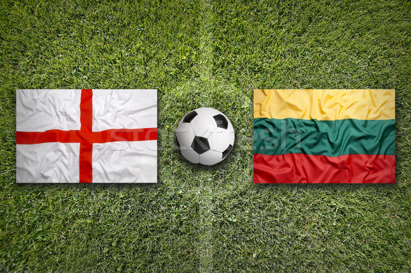 United Kingdom vs. Lithuania flags on soccer field Stock photo © kb-photodesign