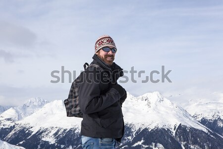 Guy is happy to be in the snowy mountains Stock photo © kb-photodesign