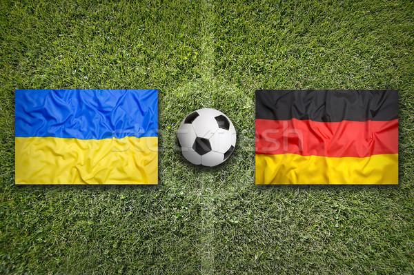 Украина против Германия флагами футбольное поле зеленый Сток-фото © kb-photodesign
