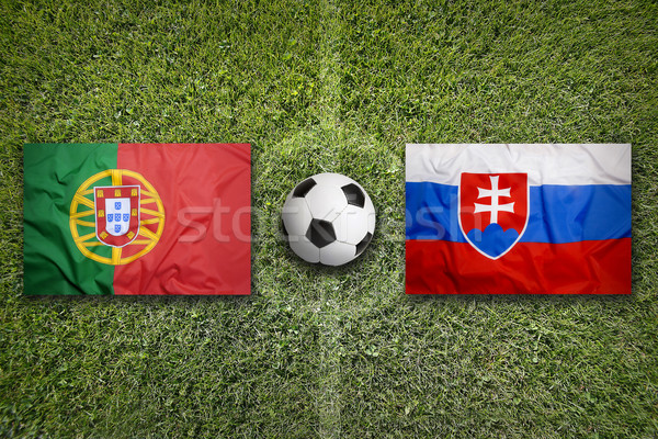 Portugal vs. Slovakia flags on soccer field Stock photo © kb-photodesign