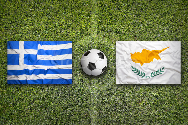 Greece and Cyprus flags on soccer field Stock photo © kb-photodesign