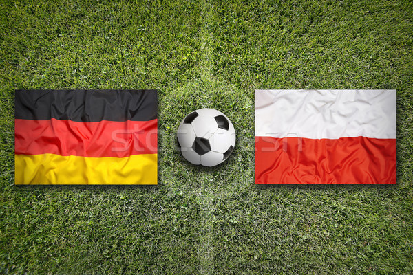 Germany vs. Poland flags on soccer field Stock photo © kb-photodesign