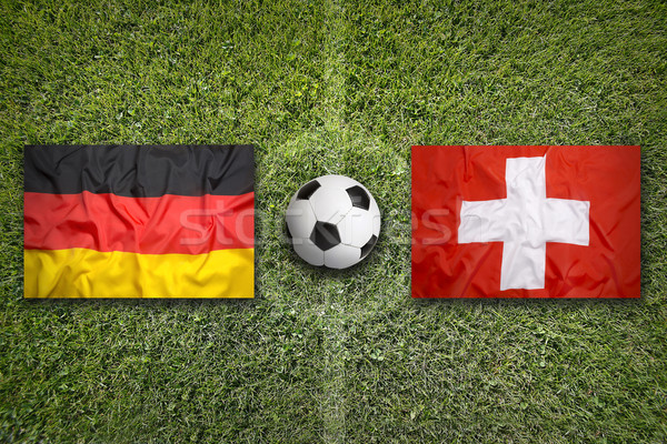 Germany vs. Switzerland flags on soccer field Stock photo © kb-photodesign