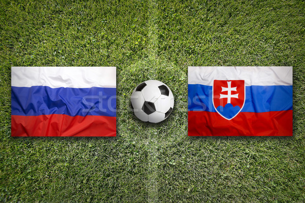 Russia vs. Slovakia flags on soccer field Stock photo © kb-photodesign