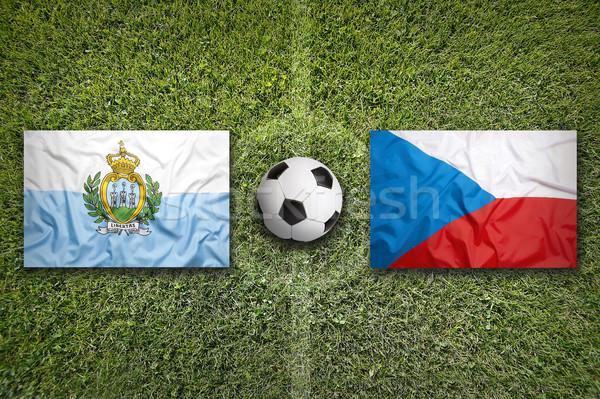 San Marino vs. Czech Republic flags on soccer field Stock photo © kb-photodesign