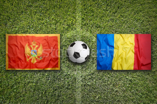 Montenegro vs. Romania flags on soccer field Stock photo © kb-photodesign