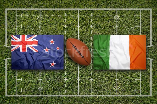 Ireland vs. ScotlandNew Zealand vs. Ireland flags on rugby fie Stock photo © kb-photodesign