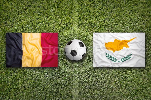 Bélgica vs Chipre bandeiras campo de futebol verde Foto stock © kb-photodesign