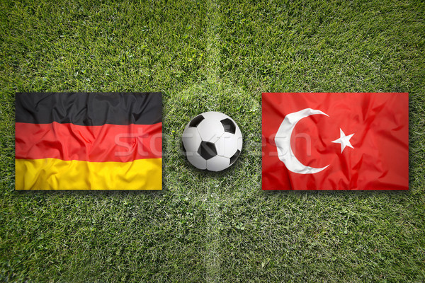 Germany vs. Turkey flags on soccer field Stock photo © kb-photodesign