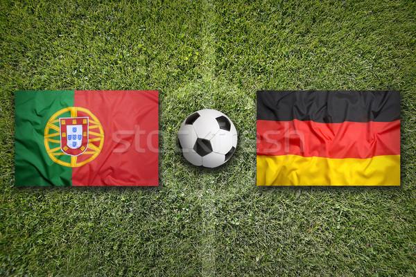Portugália vs Németország zászlók futballpálya zöld Stock fotó © kb-photodesign