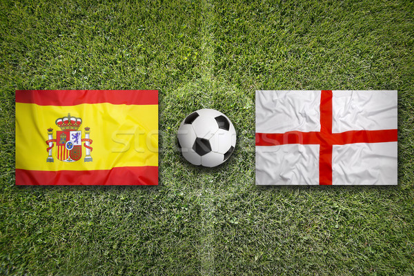 Spain vs. England flags on soccer field Stock photo © kb-photodesign