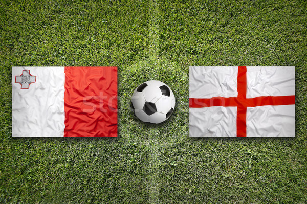 Malta vs. England flags on soccer field Stock photo © kb-photodesign