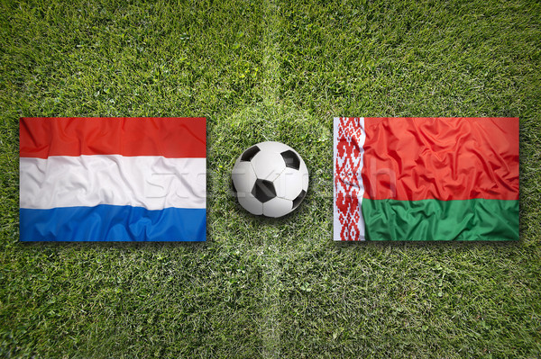 Netherlands and Belarus flags on soccer field Stock photo © kb-photodesign