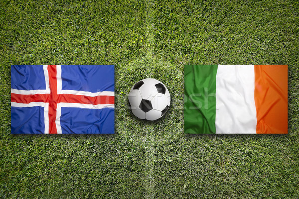 Iceland vs. Ireland flags on soccer field Stock photo © kb-photodesign