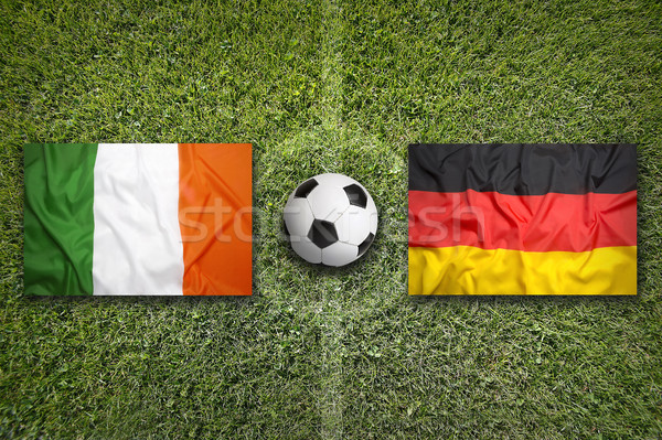 Ireland vs. Germany flags on soccer field Stock photo © kb-photodesign