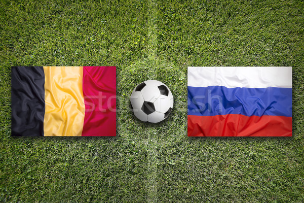 Belgium vs. Russia flags on soccer field Stock photo © kb-photodesign
