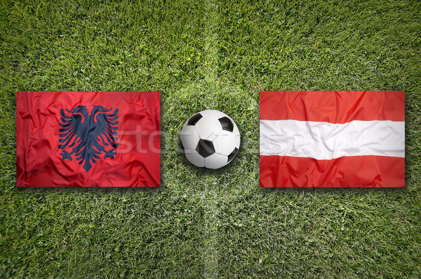 Albania vs. Austria flags on soccer field Stock photo © kb-photodesign