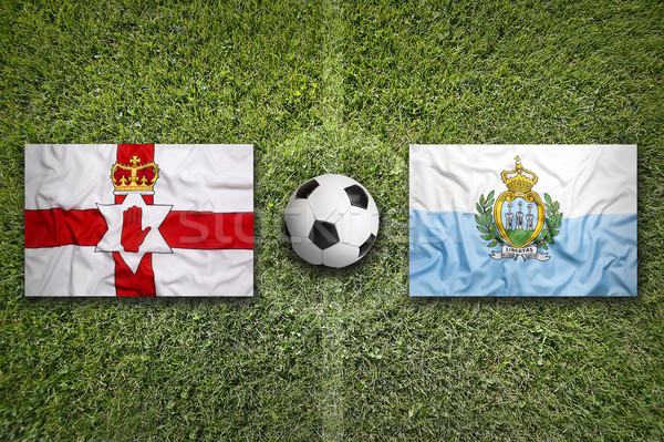 Northern Ireland and San Marino flags on soccer field Stock photo © kb-photodesign