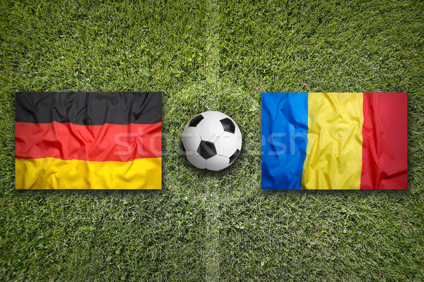 Stock photo: Germany vs. Romania flags on soccer field