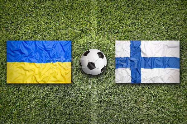 Ukraine vs. Finland flags on soccer field Stock photo © kb-photodesign